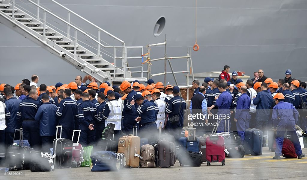 Sailors wait to embark the Gamal Abdl Nasser (ex-Vladivostok) Mistral class ship for a one week training session on May 6, 2016 in Saint-Nazaire, western France. The 'Nasser', first one of the two Mistral class ships sold by France to Egypt after its first sale cancellation to Russia, leaves Saint-Nazaire (Loire-Atlantique) on Friday for a week of Egyptian crew training at sea. / AFP / LOIC