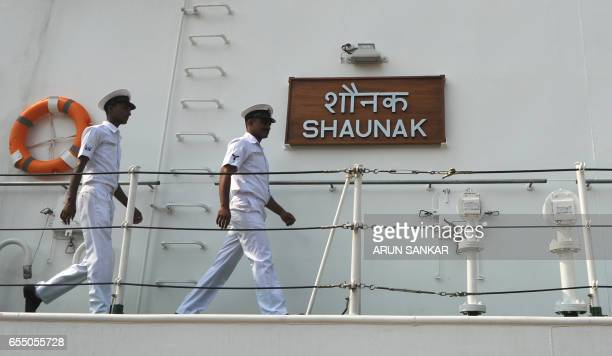 Sailors walk on deck as Indian Coast Guard Ship Shaunak a new offshore patrol vessel arrives at port in Chennai on March 19 making her maiden visit...