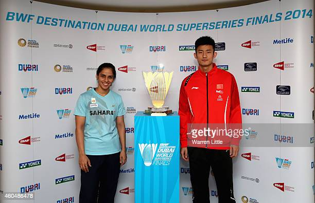 Saina Nehwal of India and Chen Long of China pose with the trophy after the draw ceremony and press conference for the BWF Destination Dubai World...