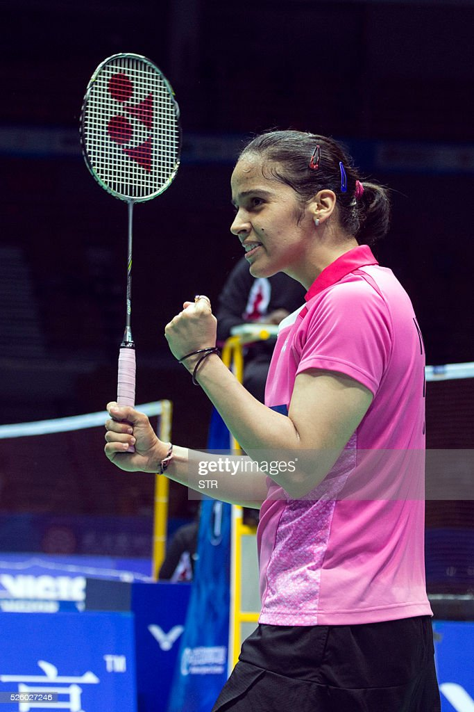 Saina Nehwal of India celebrates after winning the women's singles quarter-final match against Wang Shixian of China at the 2016 Badminton Asia Championships in Wuhan, central China's Hubei province on April 29, 2016. / AFP / STR