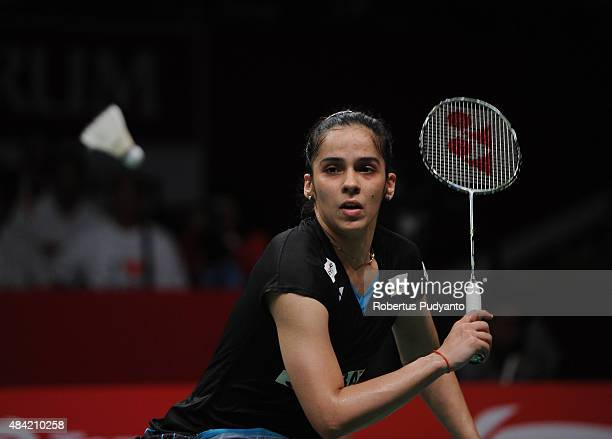 Saina Nehwal of India competes against Carolina Marin of Spain in the women singles final match of the 2015 Total BWF World Championship at Istora...