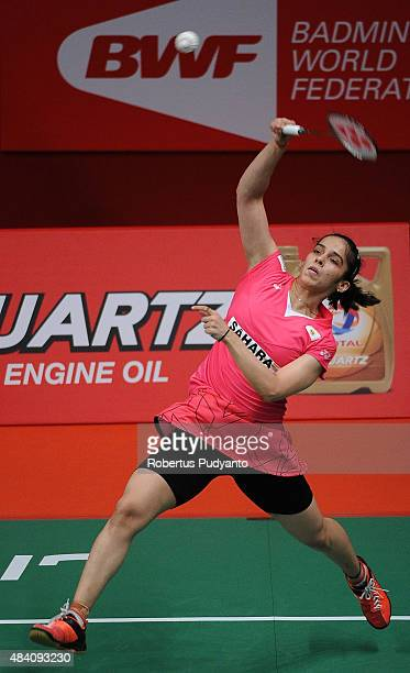 Saina Nehwal of India competes against Lindaweni Fanetri of Indonesia in the semi final match of the 2015 Total BWF World Championship at Istora...