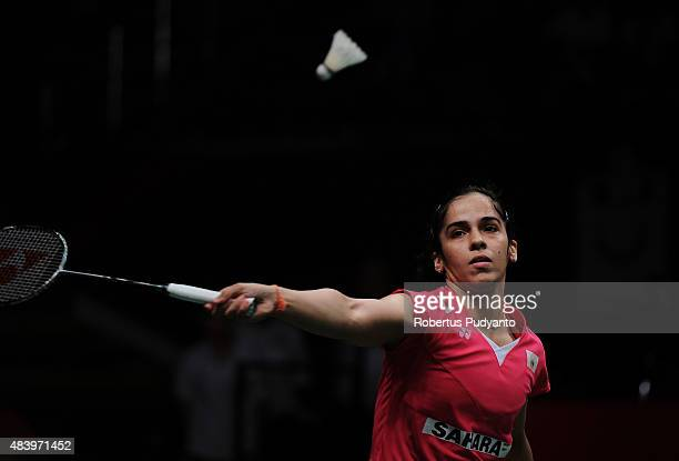Saina Nehwal of India competes against Wang Yihan of China in the quarter final match of the 2015 Total BWF World Championship at Istora Senayan on...