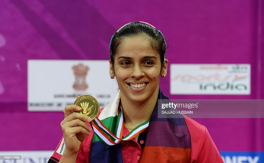 <a gi-track='captionPersonalityLinkClicked' href=/galleries/search?phrase=Saina+Nehwal&family=editorial&specificpeople=729912 ng-click='$event.stopPropagation()'>Saina Nehwal</a> of India displays her gold medal after winning her women's singles final match against Ratchanok Intanon of Thailand at the Yonex -Sunrise India Open 2015 at the Siri Fort Sports complex in New Delhi on March 29, 2015. AFP PHOTO / SAJJAD HUSSAIN
