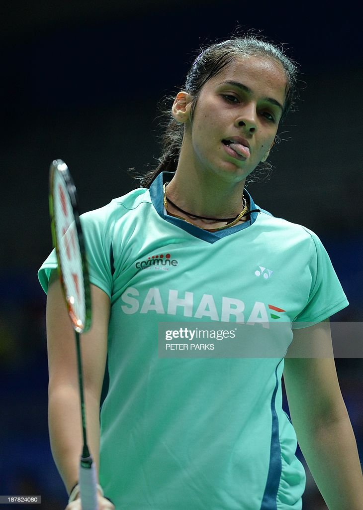 Saina Nehwal of India gestures during her game against Nozomi Okuhara of Japan in the women's singles first round at the China Open badminton tournament in Shanghai on November 13, 2013. Nehwal won the match 21-14, 21-19. AFP PHOTO/Peter PARKS