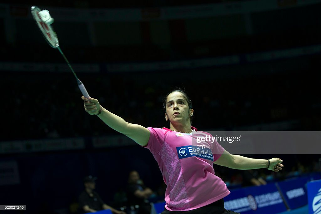 Saina Nehwal of India hits a return against Wang Shixian of China during their women's singles quarter-final match at the 2016 Badminton Asia Championships in Wuhan, central China's Hubei province on April 29, 2016. / AFP / STR