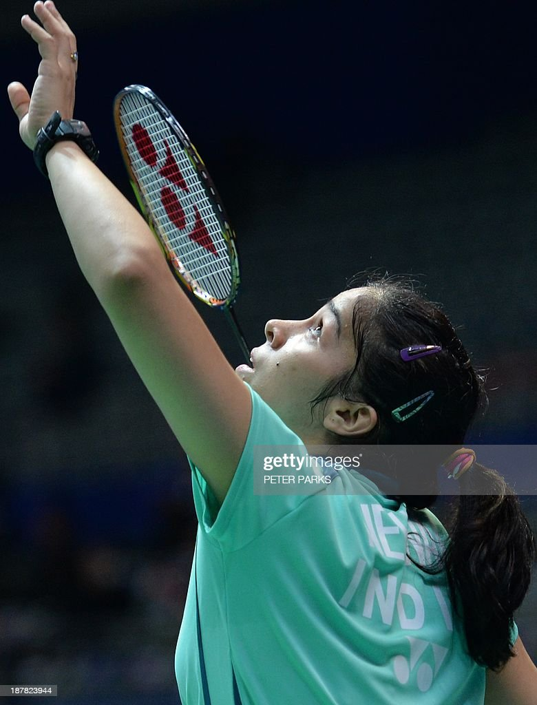 Saina Nehwal of India hits a return to Nozomi Okuhara of Japan in the women's singles first round at the China Open badminton tournament in Shanghai on November 13, 2013. Nehwal won the match 21-14, 21-19. AFP PHOTO/Peter PARKS