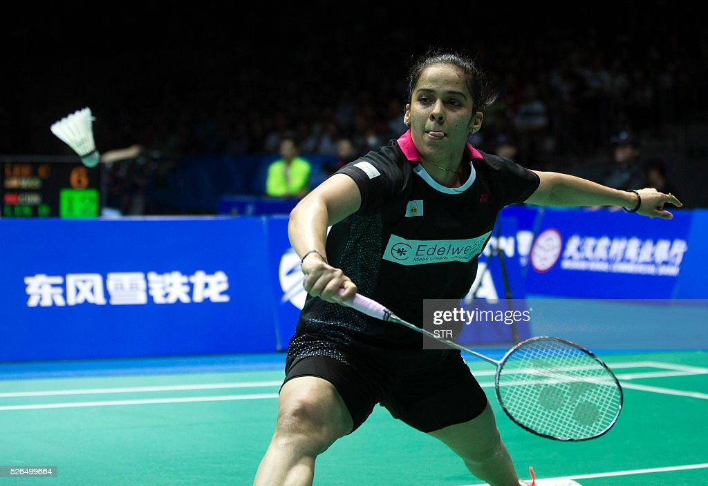 Saina Nehwal of India hits a return to Wang Yihan of China during their women's singles semi-final match at the 2016 Badminton Asia Championships in Wuhan, central China's Hubei province on April 30, 2016. / AFP / STR