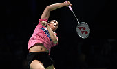 Saina Nehwal of India hits a return to Wang Yihan of China during their women's singles semifinal at the Australian Open Badminton tournament in...