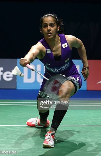 Saina Nehwal of India in action against Carolina Marin of Spain in the Women's Singles match during day two of the BWF Dubai World Superseries 2015...