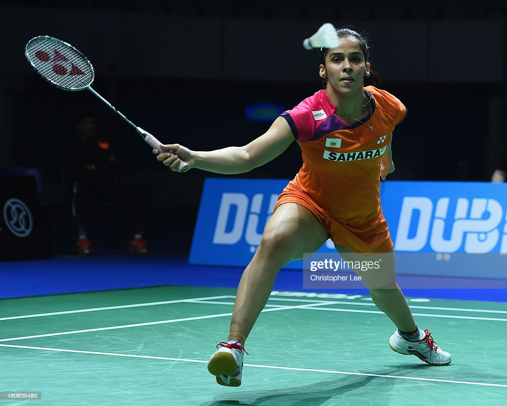 <a gi-track='captionPersonalityLinkClicked' href=/galleries/search?phrase=Saina+Nehwal&family=editorial&specificpeople=729912 ng-click='$event.stopPropagation()'>Saina Nehwal</a> of India in action against Sung Ji Hyun of Korea in the Womens Singles during day two of the BWF Destination Dubai World Superseries Finals on December 18, 2014 in Dubai, United Arab Emirates.