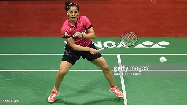 Saina Nehwal of India plays a return to Ratchanok Intanon of Thailand during their women's single final match at the Yonex Sunrise India Open 2015 at...