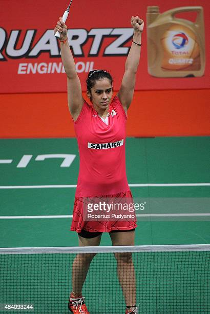 Saina Nehwal of India reacts after defeating Lindaweni Fanetri of Indonesia in the semi final match of the 2015 Total BWF World Championship at...
