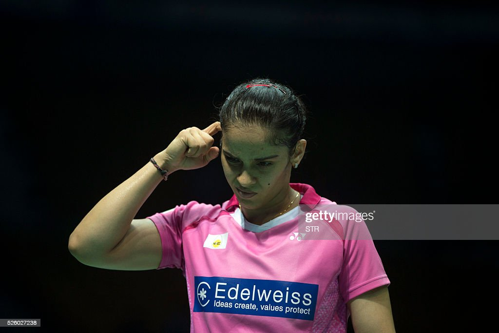 Saina Nehwal of India reacts during the women's singles quarter-final match against Wang Shixian of China at the 2016 Badminton Asia Championships in Wuhan, central China's Hubei province on April 29, 2016. / AFP / STR