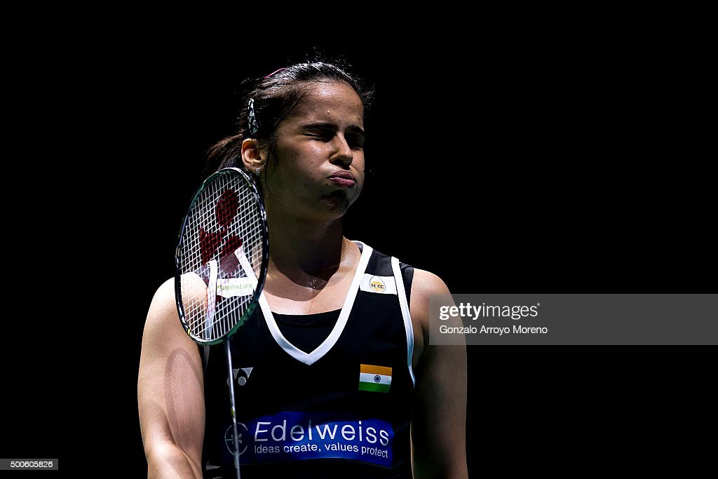 <a gi-track='captionPersonalityLinkClicked' href=/galleries/search?phrase=Saina+Nehwal&family=editorial&specificpeople=729912 ng-click='$event.stopPropagation()'>Saina Nehwal</a> of India reacts in her women's single match against Nozomi Okuhara of Japan during day one of the BWF Dubai World Superseries 2015 Finals at the Hamdan Sports Complex on on December 9, 2015 in Dubai, United Arab Emirates