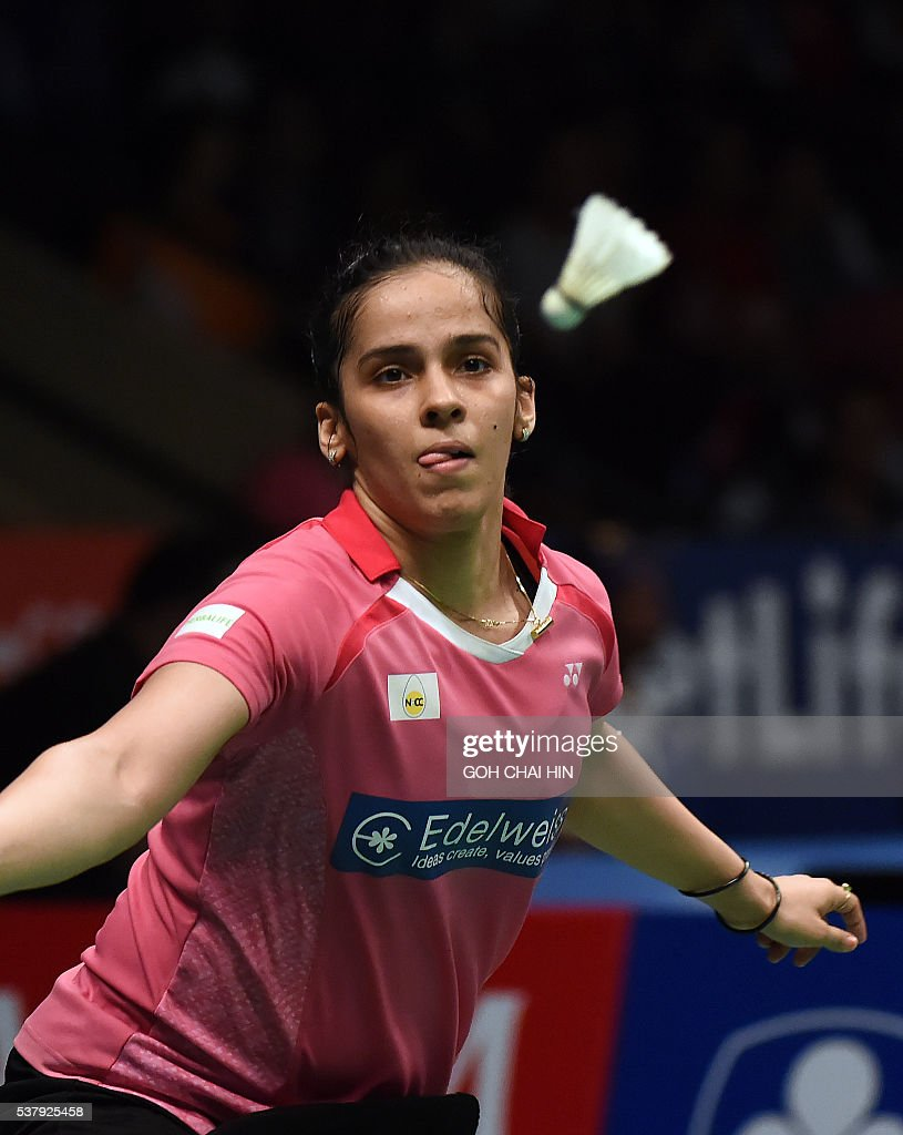 Saina Nehwal of India returns a shot against Carolina Marin of