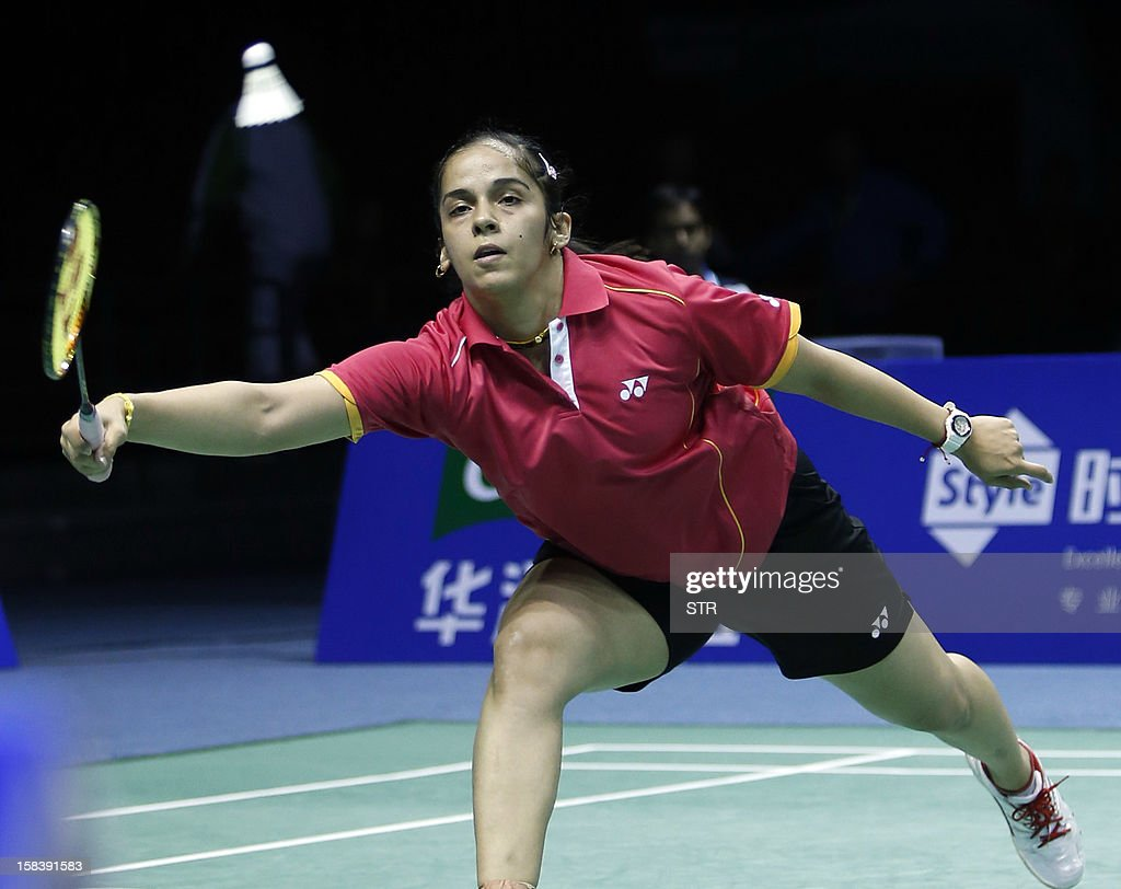 Saina Nehwal of India returns a shot against Li Xuerui of China in the women's singles event of the 2012 BWF Superseries Finals in Shenzhen, south China's Guangdong province on December 15, 2012. Li beat Nehwal 22-20, 7-21, 21-13 to move into the final. AFP PHOTO