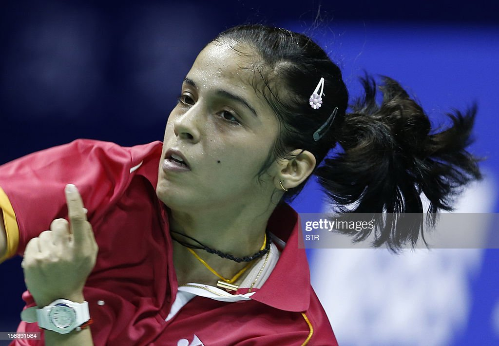 Saina Nehwal of India returns a shot against Li Xuerui of China in the women's singles event of the 2012 BWF Superseries Finals in Shenzhen, south China's Guangdong province on December 15, 2012. Li beat Nehwal 22-20, 7-21, 21-13 to move into the final.