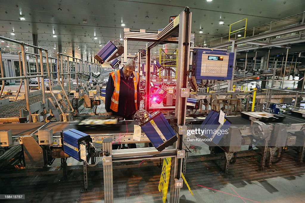A Sainsbury's employee checks scanning equipment at the Sainsbury's Waltham Point distribution depot on December 14, 2012 in Waltham Abbey, England. The depot is the largest of 23 operated by Sainsbury's to service their stores. Twelve hundred people work in the 700,000 square foot building which makes over 1800 deliveries a week to the 83 stores in the London, Hertfordshire and Essex region.