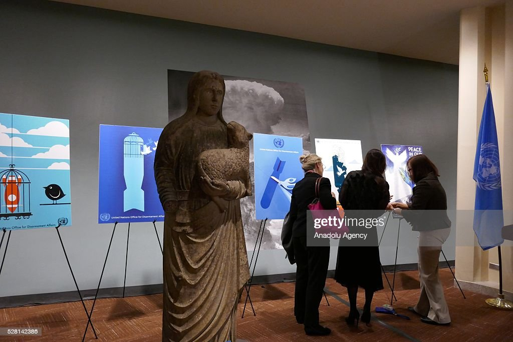 Saint Agnes stone statue, brought from Roman Catholic Cathedral ruins to United Nation, is seen at an exhibition area, in which a reception is held for ranking the highest competitors of 'Disarmament Poster for Peace' competition in New York, USA on May 4, 2016.