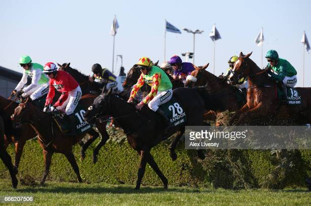 Saint Are ridden by Davy Russell clears the Water Jump on their way to third place in the 2017 Randox Health Grand National at Aintree Racecourse on...