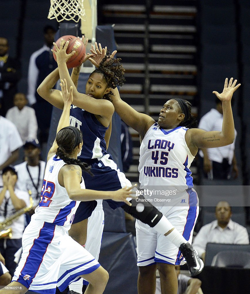 Saint Augustine's Lakiya Rouse rebounds over Elizabeth City State University's Shawnte Taylor, left, and Stephanie Harper (45) in CIAA Tournament action on Wednesday, February 27, 2013, at Time Warner Cable Arena in Charlotte, North Carolina. Elizabeth City State advanced to the semifinals, 74-68.