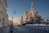 saint basil's cathedral and near buildings  from req square at sunrise in winter moscow Russia