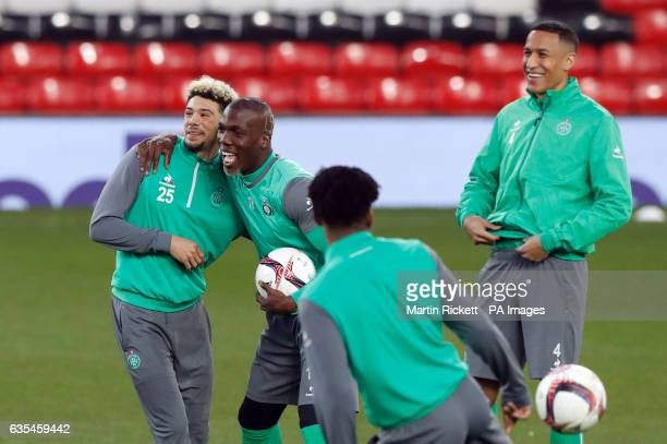Saint Etienee's Florentin Pogba and Kevin Malcuit share a joke during the training session at Old Trafford Manchester