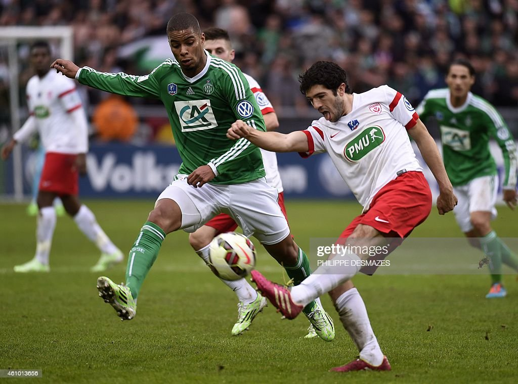 Saint Etienne forward Kevin MonnetPaquet fights for the ball with Nancy defender Vincent Muratori on January 4 2015 during a French Cup round of 64...