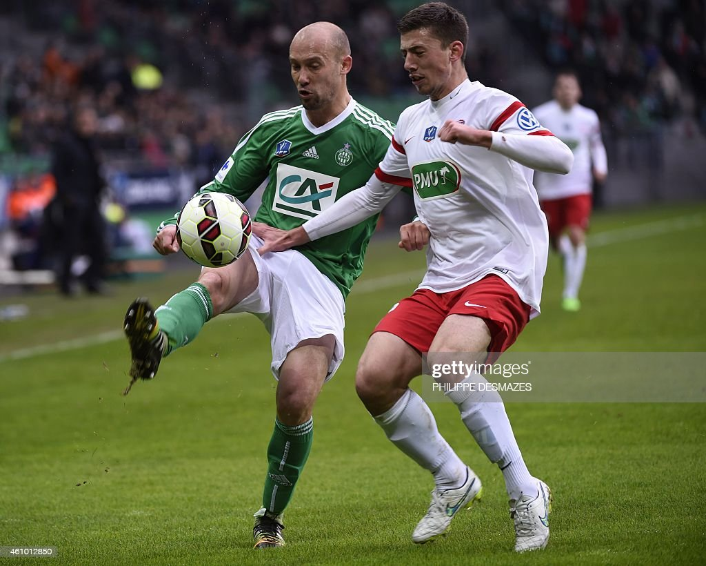 Saint Etienne midfielder <a gi-track='captionPersonalityLinkClicked' href=/galleries/search?phrase=Renaud+Cohade&family=editorial&specificpeople=2626266 ng-click='$event.stopPropagation()'>Renaud Cohade</a> (L) fights for the ball with Nancy defender Clement Lenglet (R) on January 4, 2015 during a French Cup round of 64 football match between AS Saint-Etienne and AS Nancy Lorraine at the Geoffroy Guichard stadium in the central French city of Saint-Etienne. AFP PHOTO / PHILIPPE DESMAZES
