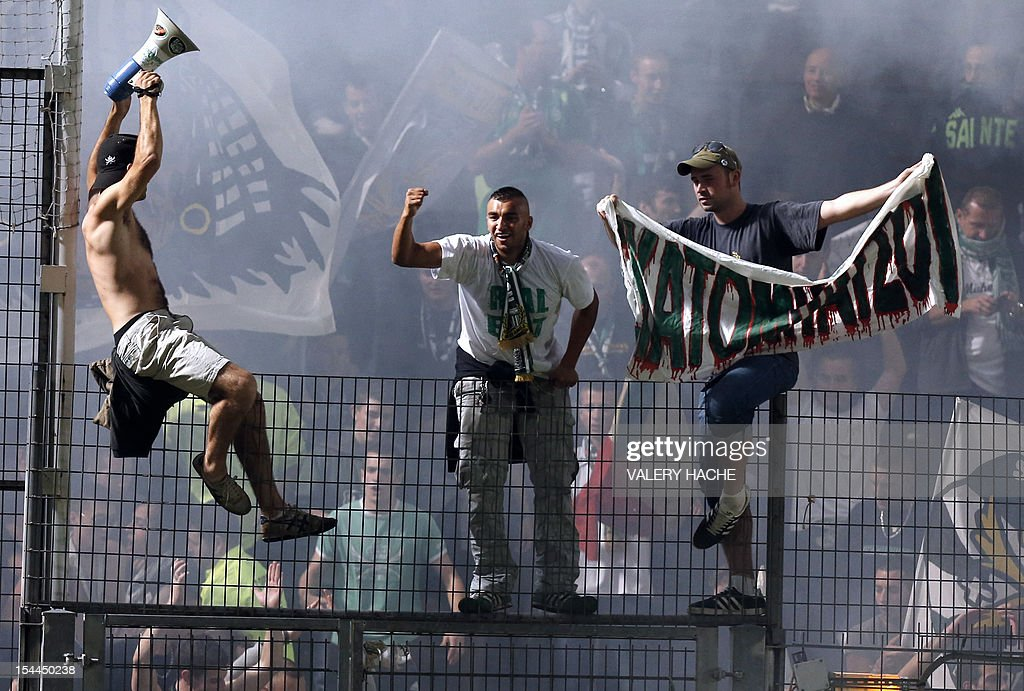 Saint Etienne supporters cheer during the French L1 football match Nice (OGCN) versus Saint-Etienne (ASSE), on october 20, 2012 at the Ray stadium in Nice, southeastern France.