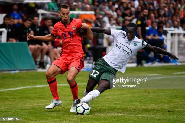 Saint Etienne's Cheik Mbengue vies with Real Sociedad's Sergio Canales Madrazo during the friendly football match between SaintEtienne and Real...