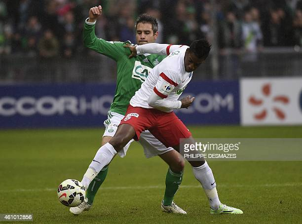 Saint Etienne's French defender Loic Perrin fights for the ball with Nancy's Malian forward Mana Dembele on January 4 2015 during a French Cup round...