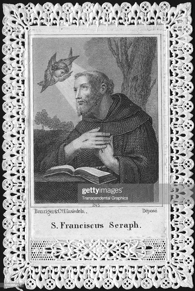 Saint Francis is visited in his library by an angelic presence in this religious card printed circa 1900 in Paris France