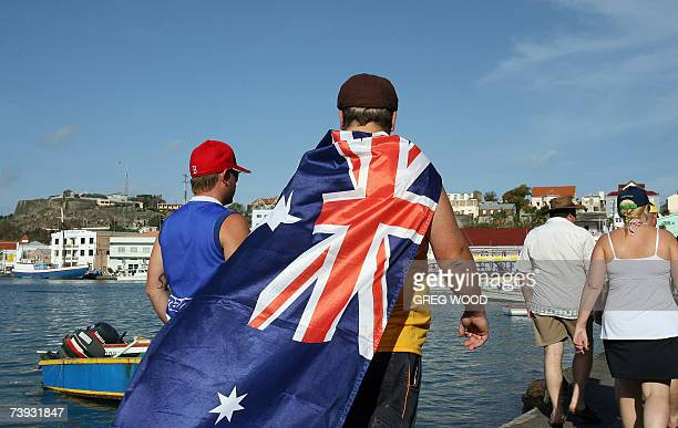 Saint George's GRENADA Australian cricket fans pass by the harbour area as they walk to the Grenada National Stadium in Saint George's 20 April 2007...