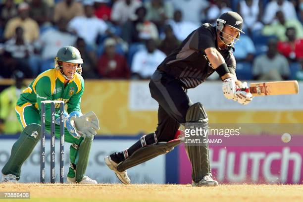 Saint George's GRENADA New Zealand's cricket team captain captain Stephen Fleming hits a baoundary off South African bowler Robin Peterson as...