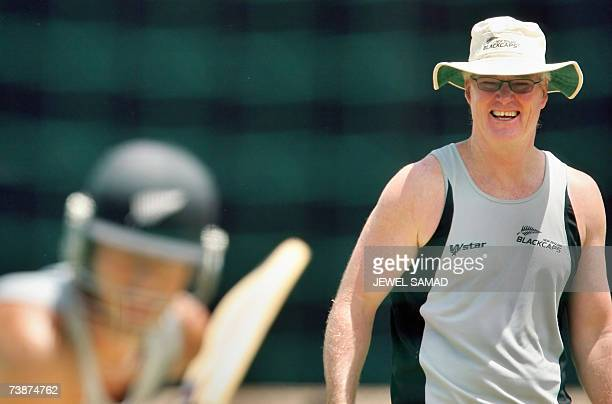 Saint George's GRENADA New Zealand's cricket team captain Stephen Fleming bats in the net as his team coach John Bracewell smiles during a practice...