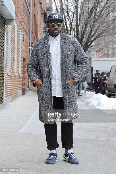 Saint Germain seen at Industria Superstudios wearing blue Nike Waffle Racer sneakers grey JCrew coat and black jeans Gucci watch Gap white shirt...