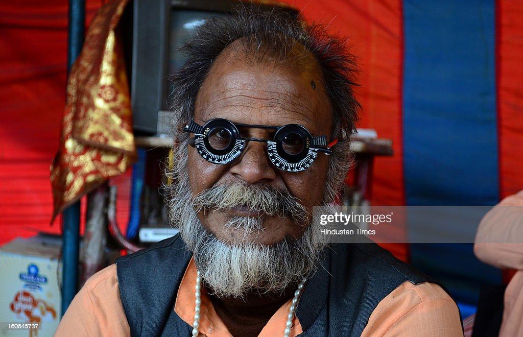 A saint getting his eyes medically examine in his camp, in a Kumbh Mela area, on February 4, 2013 in Allahabad, India.The mega religious fair is held once in 12 years in Allahabad and the third official bathing is set to take place on 'Mauni Amawasya' on February 10, 2013 during which millions of pilgrims are expected to converge from all over India and even abroad.