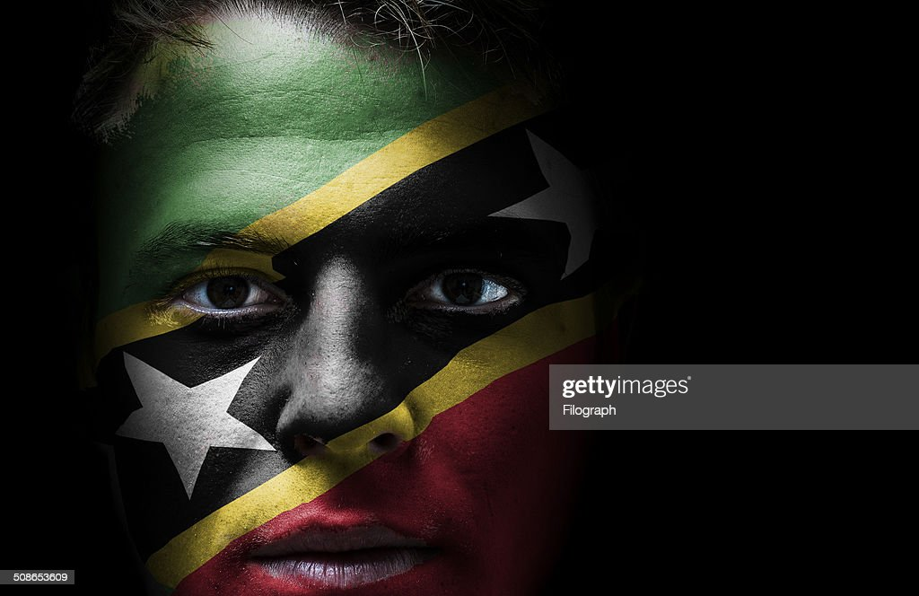 Saint Kitts and Nevis flag on face : Stock Photo