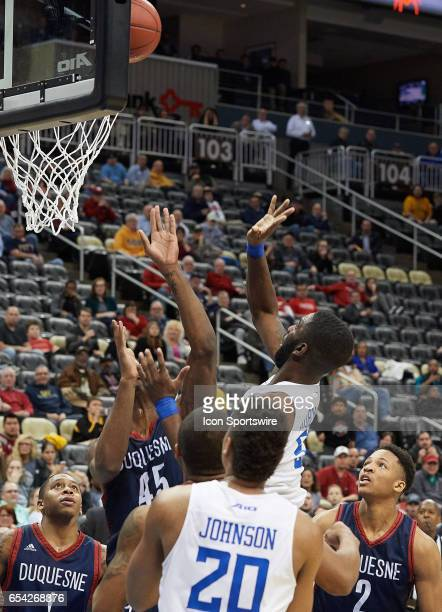 Saint Louis Billikens guard Davell Roby gets the rebound and makes the winning basket with 26 seconds left on the clock during an NCAA Atlantic 10...
