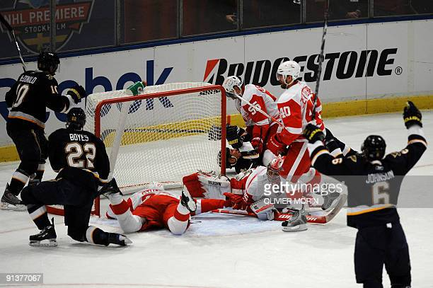 Saint Louis Blues' celebrate after scoring against the Red Wings Detroit on October 3 during a match of the 20092010 NHL ice hockey season RESTRICTED...