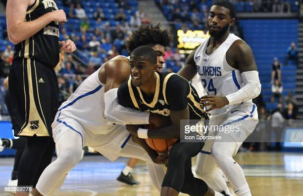 Saint Louis forward Hasahn French ties up Western Michigan guard Thomas Wilder during a nonconference basketball game between the Western Michigan...