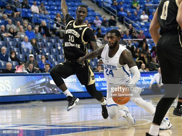 Saint Louis guard Aaron Hines drives for the basket with Western Michigan guard Thomas Wilder guarding during a nonconference basketball game between...