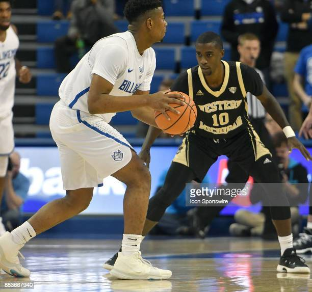 Saint Louis guard Jordan Goodwin with the ball guarded by Western Michigan guard Thomas Wilder during a nonconference basketball game between the...