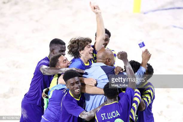 Saint Lucia celebrate victory in the boy's beach soccer gold medal final match between Saint Lucia and Trinidad Tobago on day 5 of the 2017 Youth...