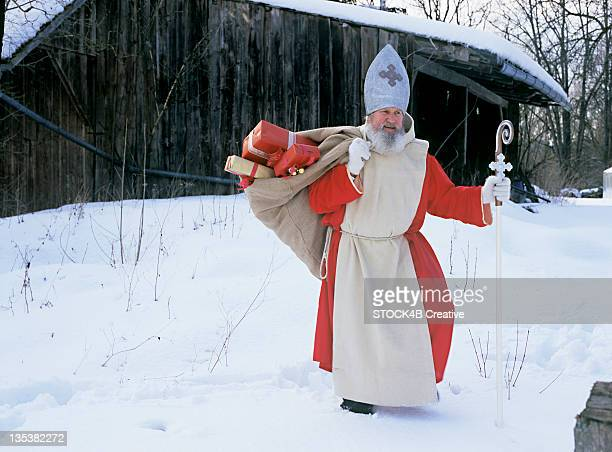 Saint Nicholas with miter and crook in snow