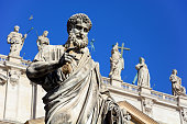 Statue of Saint Peter holding a key on St. Peter's Square in Vatican