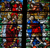 "Medieval Stained glass window depicting Jesus calling Simon Petrus (Saint Peter) to become a ""fisher of men""  in the Cathedral of Rouen, France."
