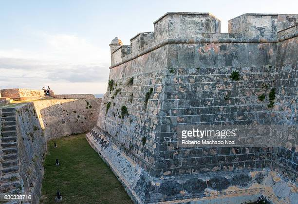 Saint Peter of the Rock castle Stone steps lead up to a perimeter stone wall with a stone fortification El Morro de Santiago de Cuba is a Unesco...